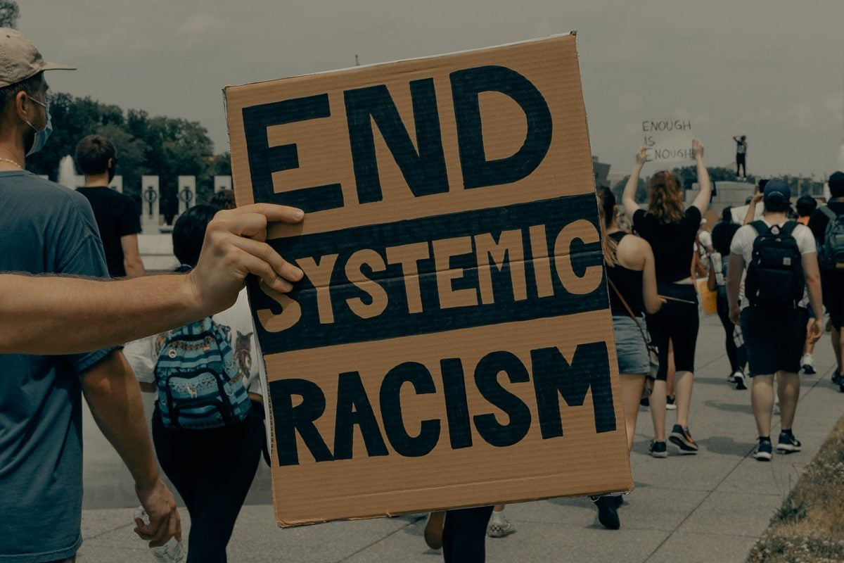 Person holding sign at a protest.