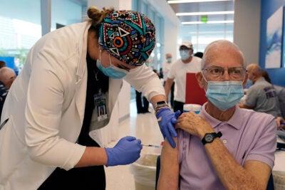 Senior citizen getting a vaccine.