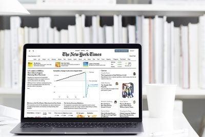Laptop displays New York Times website