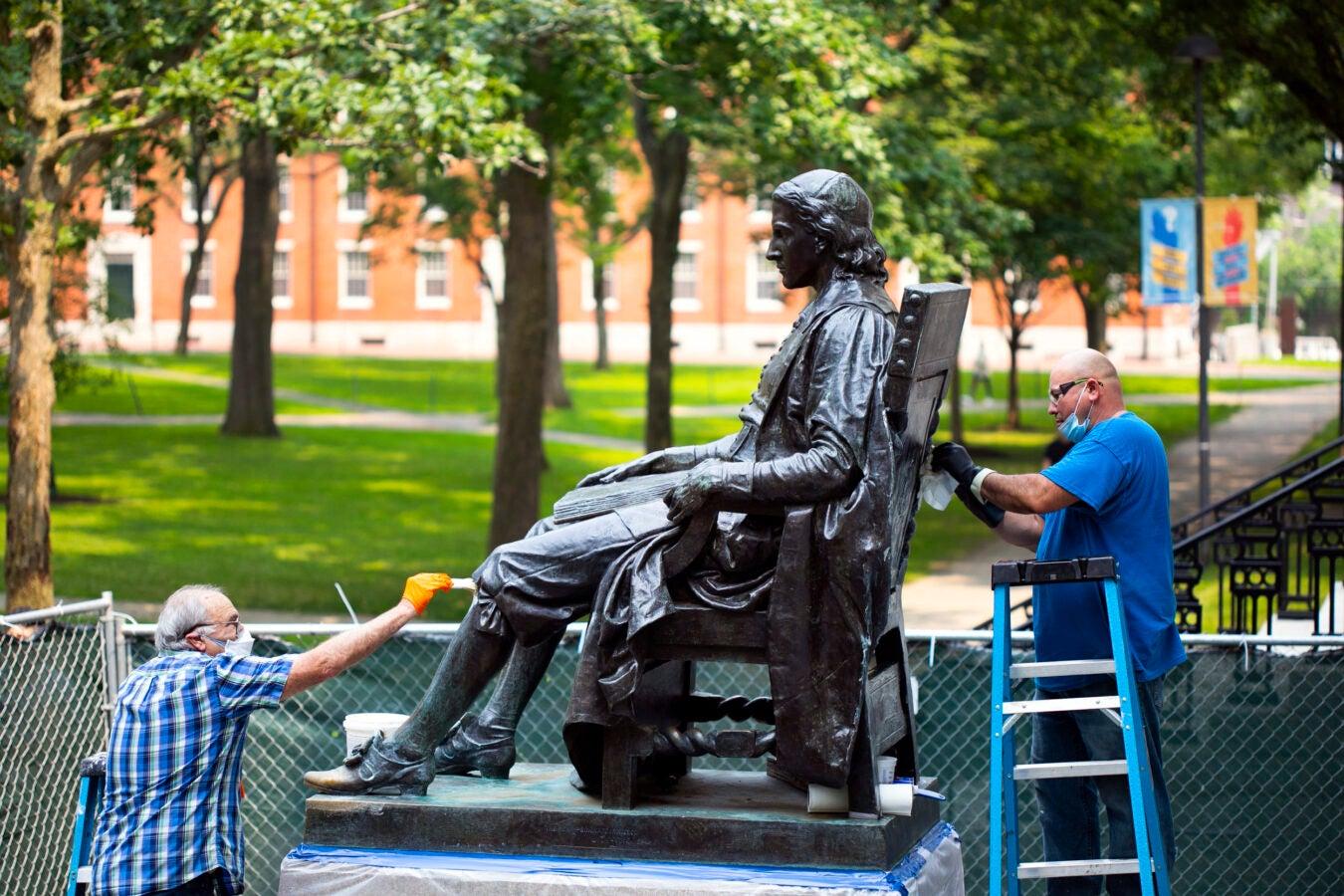 John Harvard statue restoration.