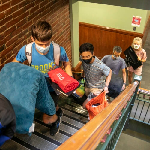 Keegan Harkavy '25 leads the way up the stairs with his parents Brad and Mador Harklavy taking up the rear.