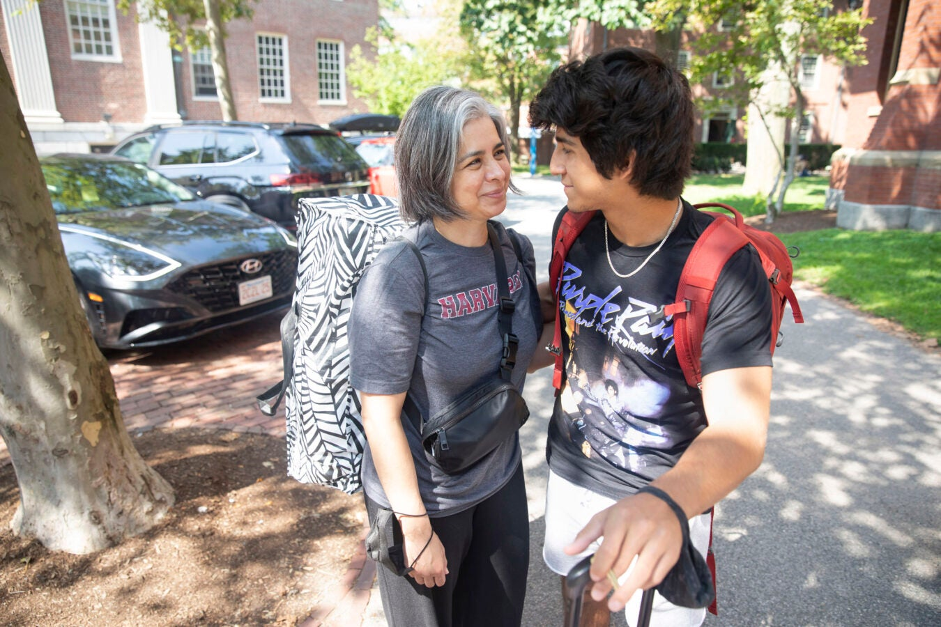 Diego Sotelo '25 is embraced by his mother, Monica.