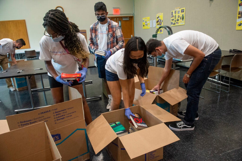 Students packing boxes.