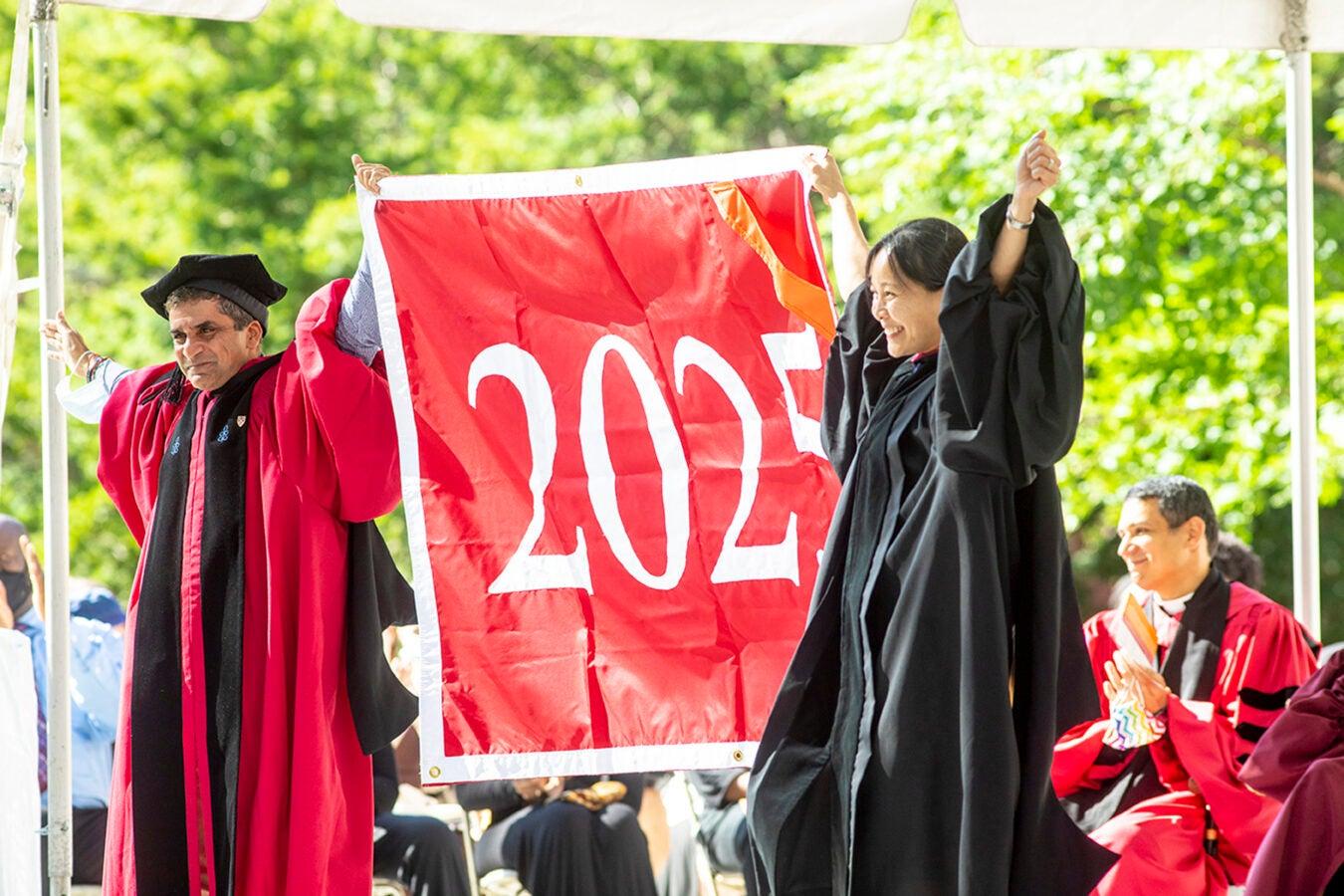 Danoff Dean of Harvard College Rakesh Khurana (left) and Vanessa Liu, president of theHarvard Alumni Association, give the Class of 2025 an enthusiastic welcome.