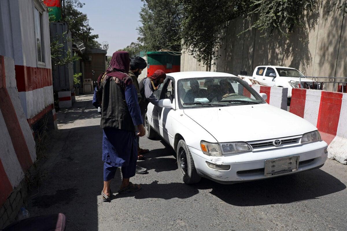Taliban checking cars.