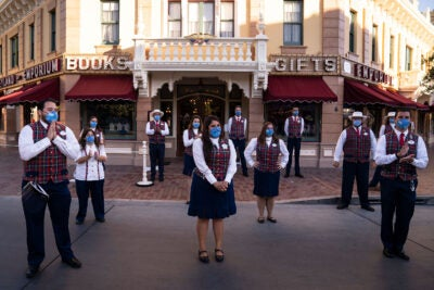 During a meeting at Disneyland in Anaheim, California, employees wear masks and stand socially distanced. The Disney Co. has a comprehensive approach to COVID and its employees' well-being.