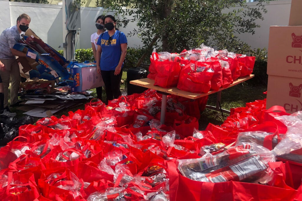 Alejandra Beltran with bags for the shelters.