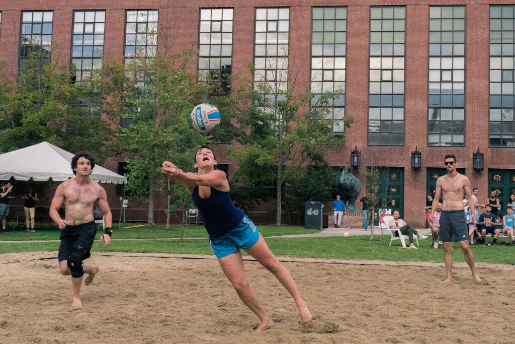 Woman playing volleyball.