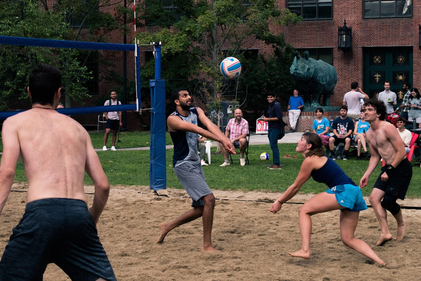 People playing volleyball.