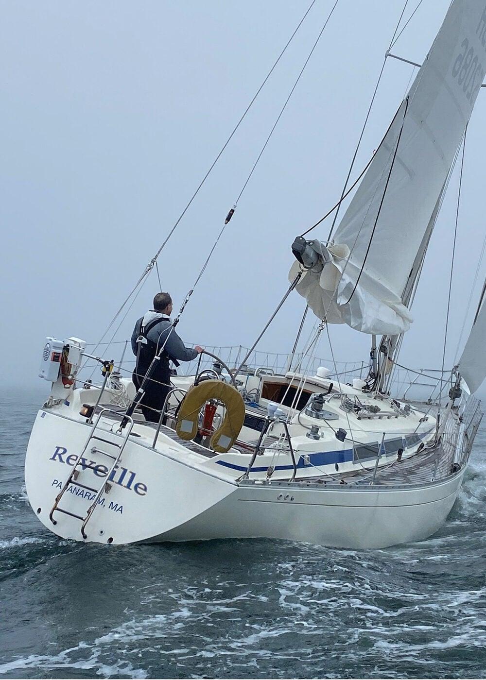 Man in sailboat.