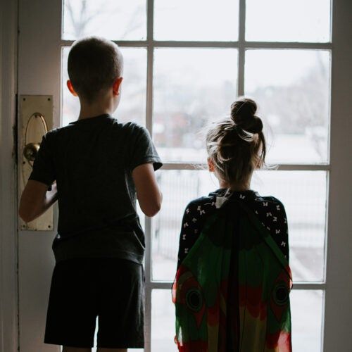 Children looking out the window.