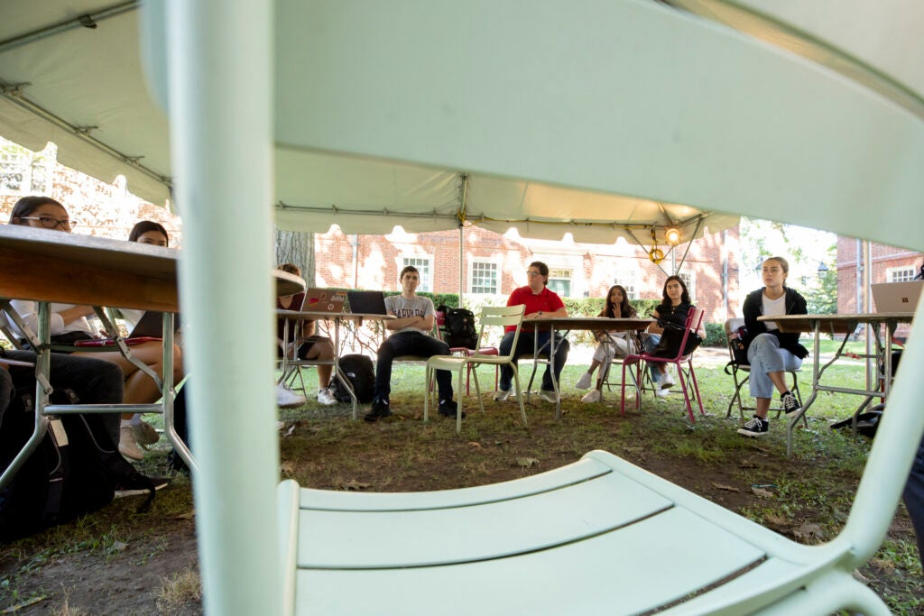 Students from William Whitham's Freshmen Seminar learn outside.