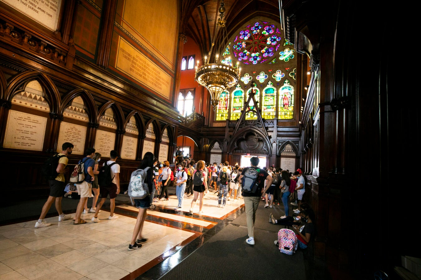 Students gather in the transept before heading into the lecture.