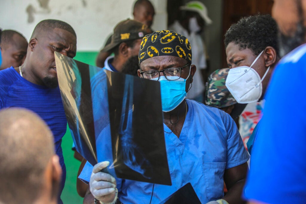 Haitian doctor looks at X-ray.