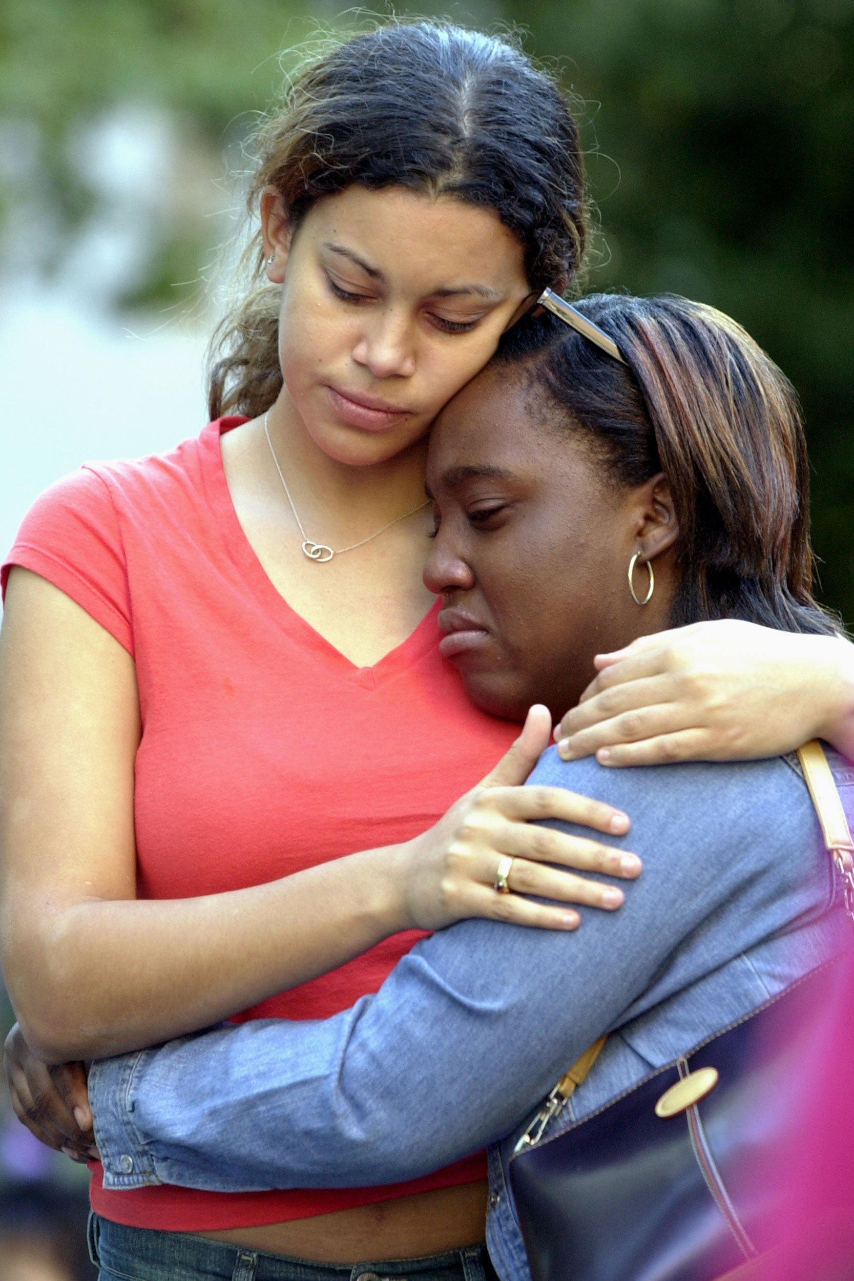 Johanna Paretzky '03 (left) and Kamala Salmon '03 held each other during the campus vigil on Sept. 11.