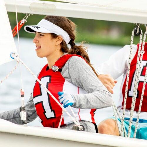 Harvard sailing team members Katie Barkin and Paul Kuechler, both '22, navigate a drill on the Charles.
