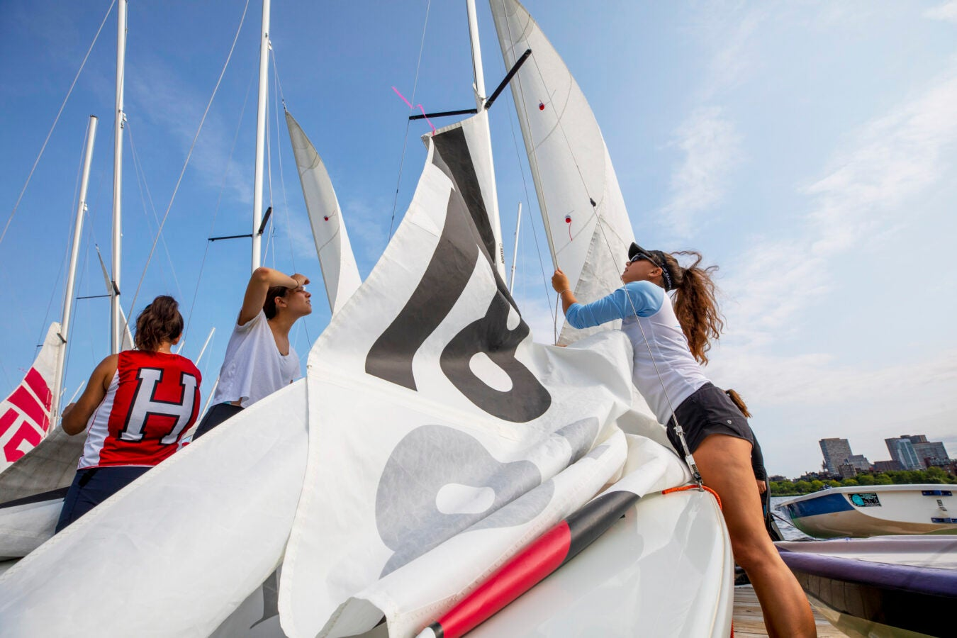 Leah Margulies, left, learns about raising sails, tying knots, and more from Corinne Lee.