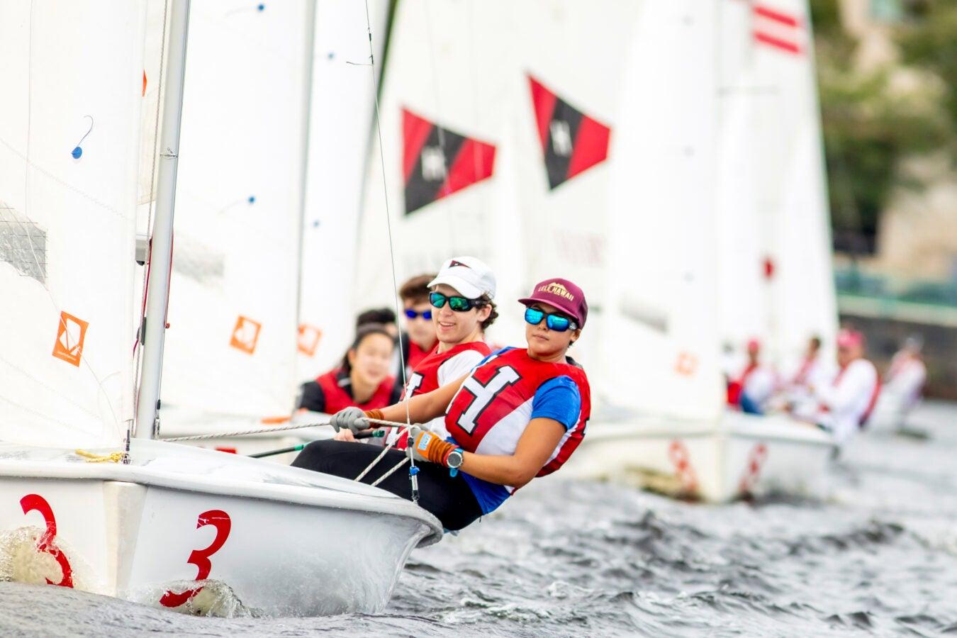Eli Burnes '22, left, is the skipper; Pomai Ogata '24 crews.