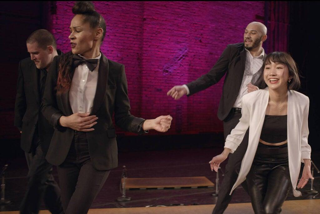 Four people dancing.