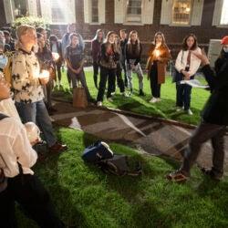 Supernatural Storytelling students meeting at night.