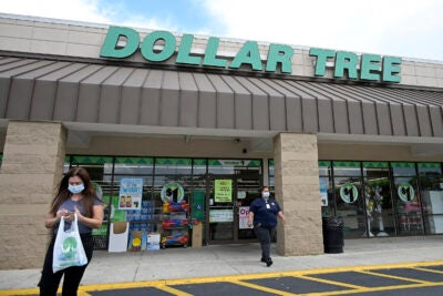 Customers leave a Dollar Tree.
