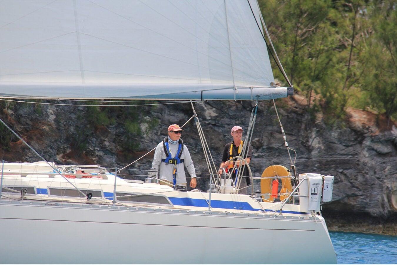Two men sailing.