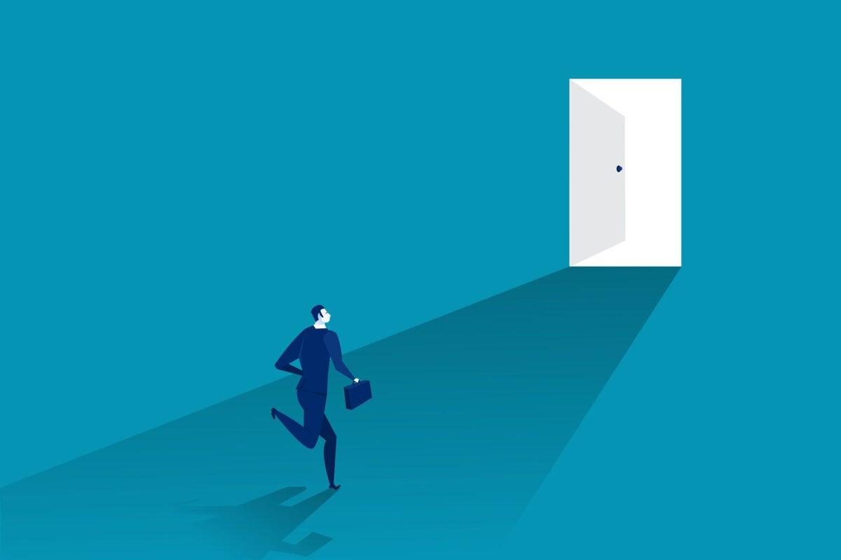 Man running for office door.