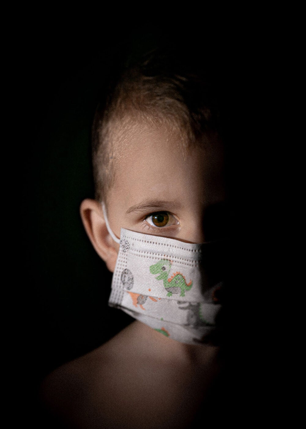 Child in a mask.
